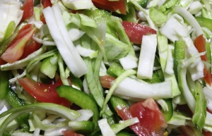 Photograph of Raw Vegetable Salad: simple salad recipe of cabbage, tomato and green capsicum in masalahealth.com