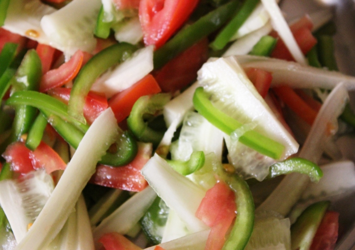 Photograph of Raw Vegetable Salad: simple salad recipe of cucumber, tomato and green capsicum in masalahealth.com